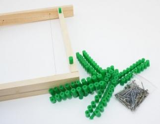 Abstandröllchen aus Kunststoff mit Drahtstifte Bild